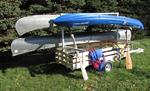 CANOE TRAILER WITH STORAGE FOR LIFE JACKETS AND PADDLES